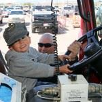 Little Boy Smiling While Driving Firetruck