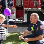 Little Girl with Balloon with Officer