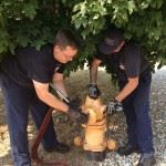 Officers Removing a Fire Hydrant