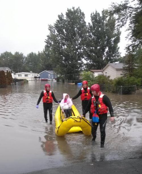 Members of the Special Operations Water team perform a rescue during the 2013 floods.