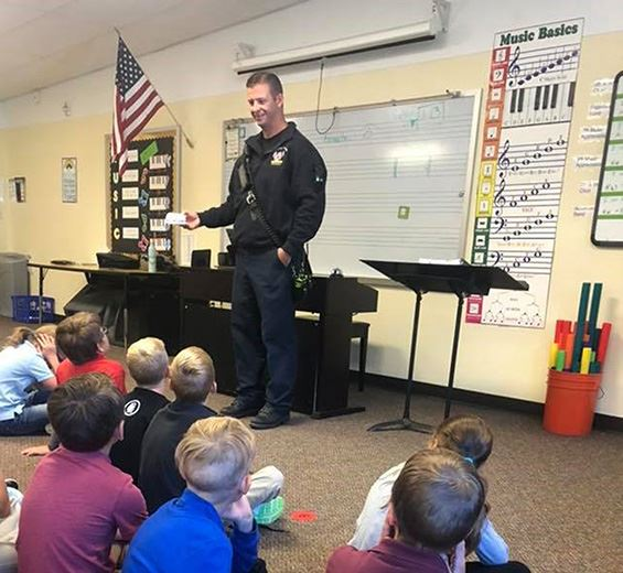 Firefighter/Paramedic Cox presents to students at Imagine Charter School in Firestone
